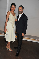 FREIDA PINTO and FRANCISCO COSTA at a dinner hosted by Calvin Klein Collection to celebrate the future Home of The Design Museum at The Commonwealth Institute, Kensington, London on 13th October 2011.