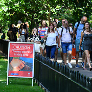 London, UK. 27 June 2019. UK Weather - The Hottest week in June 2019 a sign written (Caution - Thieves operate in this area) at St James park, London, UK