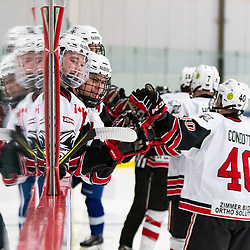 GEORGETOWN, ON - MARCH 2: Bailey Molella #11 and Justin Paul #25 celebrate with Jaden Condotta #40 of the Georgetown Raiders March 2, 2019 at Gordon Alcott Memorial Arena in Georgetown, Ontario, Canada.<br /> (Photo by Dave Fryer / OJHL Images)