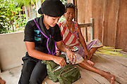 Sept. 29, 2009 -- BAAN TROKBON, THAILAND: Women in the Thai Ranger unit bring medical assistance to people in a village they entered during a patrol.  The 39 women in the 44th Army Ranger Regiment are the only Thai women seeing front line active duty against Moslem insurgents in Thailand's deep south provinces of Pattani, Narathiwat and Yala. All of the other women serving in Thai security services are employed as office and clerical workers. The Ranger women are based at the Ranger camp in the Buddhist village of Baan Trokbon in Sai Buri district of Pattani province. The unit was formed in 2006 after Muslims complained about the way Thai soldiers, all men, treated Muslim women at roadblocks and during security sweeps. The women are frequently called upon to back up Thai regular army units when they are expected to encounter a large number of Muslim women. At least two of the women have been killed by Muslim insurgents. The unit has both Muslim and Buddhist members. Many of the women in the unit joined after either their fathers or husbands were killed by insurgents.    Photo by Jack Kurtz / ZUMA Press
