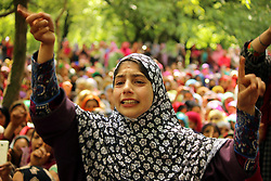 June 7, 2017 - Shopian, Jammu & Kashmir, India - A young Kashmiri Girl Shouted Pro freedom Slogans during the funeral of civilian Adil Magray at Shopian, about 60 kilometers (38 miles) south of Srinagar, Indian controlled Kashmir, Wednesday, June 7, 2017. Magray, was killed on Tuesday after government forces opened fire on protesters during a search operation to flush out Kashmiri rebels in the southern town of Indian controlled Kashmir, police said. (Credit Image: © Muneeb Ul Islam/Pacific Press via ZUMA Wire)