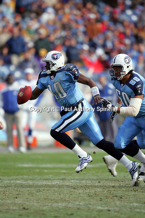 NASHVILLE, TN - DECEMBER 3:  Rookie quarterback Vince Young #10 of the Tennessee Titans runs the ball while completing 15 of 25 passes for 163 yards and two touchdowns to go with his 78 yards rushing against the Indianapolis Colts at LP Field on December 3, 2006 in Nashville, Tennessee. The Titans defeated the Colts 20-17. ©Paul Anthony Spinelli *** Local Caption *** Vince Young