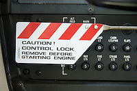 "Control lock warning sign on a Cessna 172: ""Caution! Control Lock - remove before starting engine"""