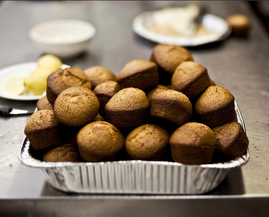 tin full of cornbread muffins in restauarnt kitchen