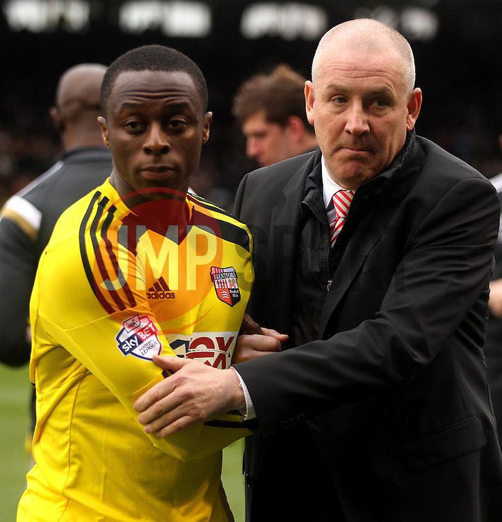 Brentford Manager, Mark Warburton talks to Brentford's Moses Odubajo - Photo mandatory by-line: Robbie Stephenson/JMP - Mobile: 07966 386802 - 03/04/2015 - SPORT - Football - Fulham - Craven Cottage - Fulham v Brentford - Sky Bet Championship