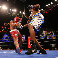 WINTER PARK, FL - AUGUST 02: John Jackson (R) knocks Dennis Laurente off balance during the Premier Boxing Champions on Bounce TV boxing match at Full Sail University - Ebbs Auditorium on August 2, 2015 in Winter Park, Florida. Jackson won the bout.  (Photo by Alex Menendez/Getty Images) *** Local Caption *** John Jackson; Dennis Laurente