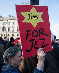 © Licensed to London News Pictures. 26/03/2018. London, UK. Supporters of Jeremy Corbyn hold a counter demonstration as members of the Jewish community, Jewish leaders and supporters hold a demonstration outside the Houses of Parliament in London against Jeremy Corbyn, who they accuse of not acting on anti-semitic behaviour in the Labour Party. Photo credit: Ben Cawthra/LNP