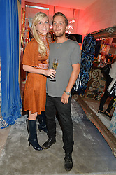 MADDIE CHESTERTON Director of Baar & Bass and RORY SHEARER at a party to celebrate the launch of Baar & Bass, 336 Kings Road, London on 9th September 2014.