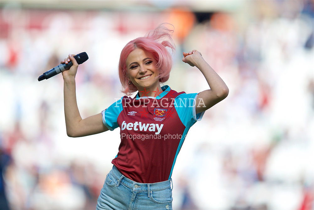 "LONDON, ENGLAND - Saturday, April 22, 2017: Singer Victoria Louise Lott ""Pixie Lott"" performs at half-time during the FA Premier League match between West Ham United and Everton at the London Stadium. (Pic by David Rawcliffe/Propaganda)"