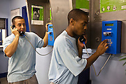 Prisoners using the payphones on E wing. HMP Wandsworth, London, United Kingdom