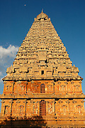 "The Brihadishwara Temple  also known as Rajarajeswaram, at Thanjavur, is the world's first complete granite temple and a brilliant example of the major heights achieved by Cholas in temple architecture. It is a tribute and a reflection of the power of its patron RajaRaja Chola I. It remains as one of the greatest glories of Indian architecture. The temple is part of the UNESCO World Heritage Site ""Great Living Chola Temples"" and this temple is an ultimate testimonial for the vishwakarmas architectural cognizence in planning and sculpting this temple..This temple is one of India's most prized architectural sites. The temple stands amidst fortified walls that were probably added in the 16th century. The 'Vimana' - or the temple tower - is 216+ft (66+m) high [4] (about 70 meters) and is among the tallest of its kind in the world. The Kalash or 'Shikhara' (apex or the bulbous structure on the top) of the temple is of monolithic granite weighing 81.25 tons. There is a big statue of Nandi (sacred bull), carved out of a single rock, at the entrance measuring about 16 feet long and 13 feet high. The entire temple structure is made out of hard granite stones, a material sparsely available currently in Thanjavur area where the temple is located."