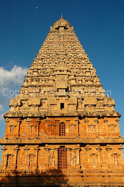 """The Brihadishwara Temple  also known as Rajarajeswaram, at Thanjavur, is the world's first complete granite temple and a brilliant example of the major heights achieved by Cholas in temple architecture. It is a tribute and a reflection of the power of its patron RajaRaja Chola I. It remains as one of the greatest glories of Indian architecture. The temple is part of the UNESCO World Heritage Site """"Great Living Chola Temples"""" and this temple is an ultimate testimonial for the vishwakarmas architectural cognizence in planning and sculpting this temple..This temple is one of India's most prized architectural sites. The temple stands amidst fortified walls that were probably added in the 16th century. The 'Vimana' - or the temple tower - is 216+ft (66+m) high [4] (about 70 meters) and is among the tallest of its kind in the world. The Kalash or 'Shikhara' (apex or the bulbous structure on the top) of the temple is of monolithic granite weighing 81.25 tons. There is a big statue of Nandi (sacred bull), carved out of a single rock, at the entrance measuring about 16 feet long and 13 feet high. The entire temple structure is made out of hard granite stones, a material sparsely available currently in Thanjavur area where the temple is located."""