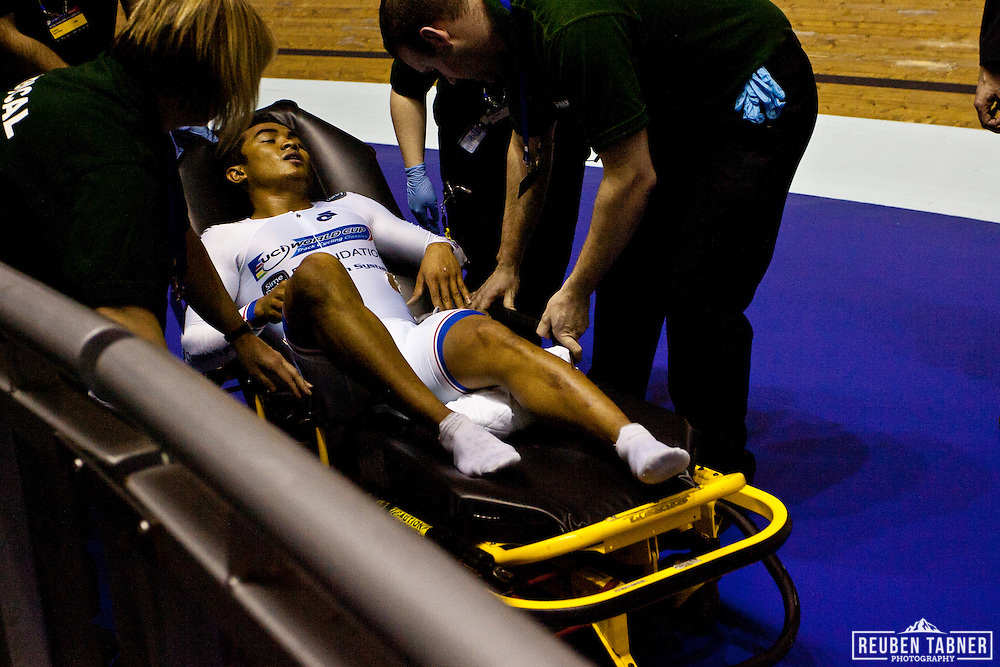 Azizulhasni Awang is taken away on a stretcher after crashing during the final of the men's keirin. He had a splinter through his leg. But finished the race to take Bronze...A major crash on the final bend of the Men's Keirin, Final left a number of injuries. The worst appeared to be a splinter which penetrated right through the leg of the Malaysian rider Azizulhasni Awang.