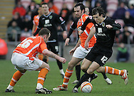 Blackpool - Saturday March 7th, 2009: Charlie Adam (l) and Gary Taylor-Fletcher (c) of Blackpool put pressure on Alan Gow of Norwich City during the Coca Cola Championship match at Bloomfield Road, Blackpool. (Pic by Michael Sedgwick/Focus Images)
