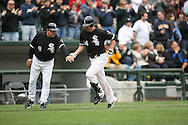CHICAGO - APRIL 27:  Paul Konerko #14 of the Chicago White Sox celebrates with Jeff Cox after hitting the second of two home runs during the game against the Baltimore Orioles at U.S. Cellular Field in Chicago, Illinois on April 27, 2008.  The White Sox defeated the Orioles 6-1.  (Photo by Ron Vesely)