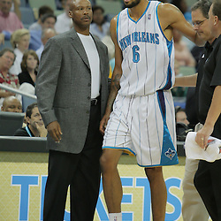 05 October 2008: New Orleans Hornets center Tyson Chandler (6) is helped off the court by team trainers and New Orleans Hornets coach Byron Scott looks on from the bench during a NBA preseason game between the Golden State Warriors and the New Orleans Hornets at at the New Orleans Arena in New Orleans, LA..