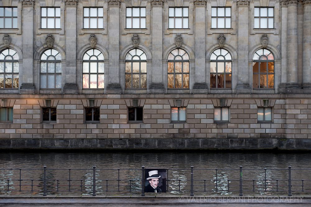 A picture hung on a rail along the Spree, Berlin River encircling the Island of museums (Museumsinsel)