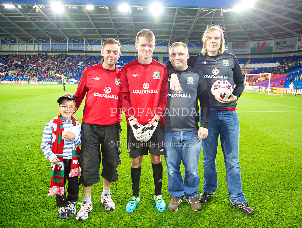 CARDIFF, WALES - Wednesday, August 14, 2013: Vauxhall competition winners take part in a penalty shoot-out during half-time of the International Friendly between Wales and Republic of Ireland at the Cardiff City Stadium. (Pic by David Rawcliffe/Propaganda)