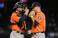 PHOENIX, AZ - AUGUST 15:  Max Stassi #12 and Brad Peacock #41 of the Houston Astros talk on the mound in the fourth inning of the MLB game against the Arizona Diamondbacks at Chase Field on August 15, 2017 in Phoenix, Arizona.  (Photo by Jennifer Stewart/Getty Images)