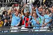 Vincent Kompany (4) of Manchester City lifts the FA Cup in the Royal Box during the The FA Cup Final match between Manchester City and Watford at Wembley Stadium, London, England on 18 May 2019.