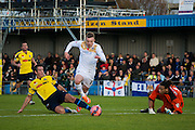 Brett Poate fouls Freddie Sears during the The FA Cup match between Gosport Borough and Colchester United at Privett Park, Gosport, United Kingdom on 9 November 2014.
