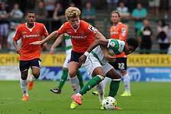 Sean Jeffers of Yeovil Town is tackled by Cameron McGeehan of Luton Town - Photo mandatory by-line: Harry Trump/JMP - Mobile: 07966 386802 - 22/08/15 - SPORT - FOOTBALL - Sky Bet League Two - Yeovil Town v Luton Town - Huish Park, Yeovil, England.