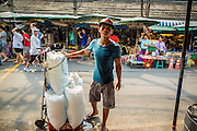 16 FEBRUARY 2013 - BANGKOK, THAILAND:  An ice seller looks for customers in Chatuchak Weekend Market in Bangkok. It is reportedly the largest market in Thailand and the world's largest weekend market. Frequently called J.J., it covers more than 35 acres and contains upwards of 5,000 stalls.        PHOTO BY JACK KURTZ
