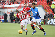 Rangers defender Connor Goldson (6) pushes Hamilton Accademical forward Mickel Miller (11) off the ball during the Ladbrokes Scottish Premiership match between Hamilton Academical FC and Rangers at New Douglas Park, Hamilton, Scotland on 24 February 2019.
