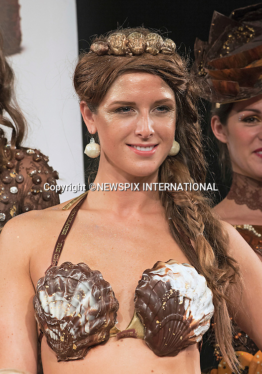15.10.2015; London, England: CHOCOLATE FASHION SHOW<br /> <br /> Outfits worn for the show were constructed mainly from chocolate and included a mermaid from Aneesh Popat The Chocolatier and another inspired by Doctor Who, created by The Fat Duck.<br /> The mermaid dress titled &quot;The Goddess of the Sea&quot;, featured gold scales dipped.<br /> The Salon du Chocolat held at Olympia, runs for 3 days until 18th October 2015.<br /> <br /> **ALL FEES PAYABLE TO: &quot;NEWSPIX INTERNATIONAL&quot;**<br /> <br /> PHOTO CREDIT MANDATORY!!: NEWSPIX INTERNATIONAL(Failure to credit will incur a surcharge of 100% of reproduction fees)<br /> <br /> IMMEDIATE CONFIRMATION OF USAGE REQUIRED:<br /> Newspix International, 31 Chinnery Hill, Bishop's Stortford, ENGLAND CM23 3PS<br /> Tel:+441279 324672  ; Fax: +441279656877<br /> Mobile:  0777568 1153<br /> e-mail: info@newspixinternational.co.uk