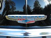 chrome emblem on hood of vintage car