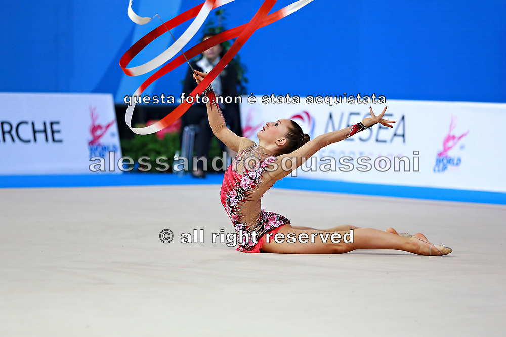 Kratochwill Spela during qualifying at ribbon in Pesaro World Cup at Adriatic Arena on 11 April 2015. Spela is a Slovenian individual rhythmic gymnast  born January 27, 1998 in Ljubljana, Slovenia.