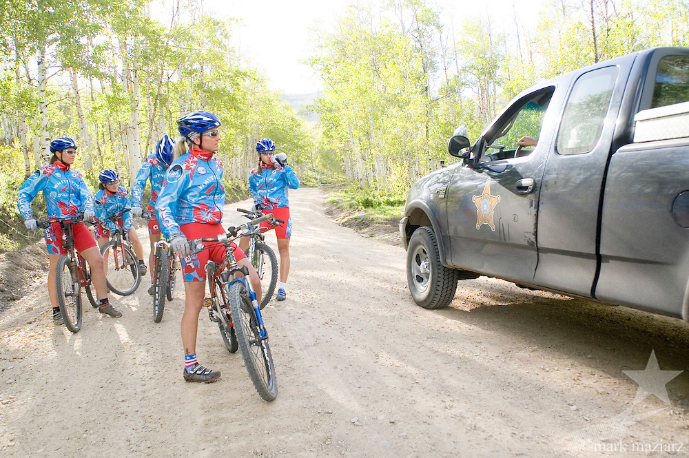 group of woman riders down dirt road