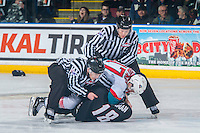 KELOWNA, CANADA - FEBRUARY 10: Linesmen Dustin Minty and Kevin Crowell break up Rodney Southam #17 of the Kelowna Rockets and Jack Flaman #18 of the Vancouver Giants on February 10, 2017 at Prospera Place in Kelowna, British Columbia, Canada.  (Photo by Marissa Baecker/Shoot the Breeze)  *** Local Caption ***