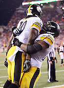 Pittsburgh Steelers wide receiver Martavis Bryant (10) gets a lift in the air from Pittsburgh Steelers tackle Marcus Gilbert (77) after making a sensational catch on a third quarter touchdown pass reception that gives the Steelers a 15-0 lead during the NFL AFC Wild Card playoff football game against the Cincinnati Bengals on Saturday, Jan. 9, 2016 in Cincinnati. The Steelers won the game 18-16. (©Paul Anthony Spinelli)