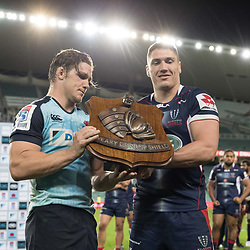 Sean McMahon of the Melbourne Rebels presents the Weary Dunlop shield to Michael Hooper of the Waratahs during the super rugby match between Waratahs and the Rebels Allianz Stadium 21 May 2017(Photo by Mario Facchini -Steve Haag Sports)