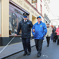 Chief Supt of the Clare Garda Division John Kerins  helped by Sean Murphy of Seeking Vision Clare at the 'Walk a mile for the Blind'