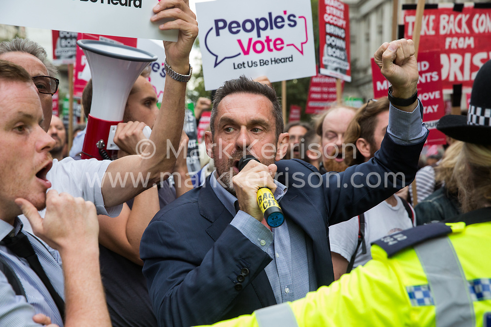 London, UK. 2 September, 2019. Journalist Paul Mason (c) addresses hundreds of people attending a 'Stop the Coup' protest in Whitehall as Prime Minister Boris Johnson makes an address to the nation outside 10 Downing Street to the effect that there will be a vote on a general election if MPs vote for a further delay to Brexit.