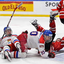 WHITBY, - Dec 16, 2015 -  Game #8 - Czech Republic vs. Canada East at the 2015 World Junior A Challenge at the Iroquois Park Recreation Complex, ON. Ondrej Kachyna #7 and Ondrej Najman #10 of Team Czech Republic get tangled with Tyler Rollo #18 of Team Canada East during the first period.<br /> (Photo: Shawn Muir / OJHL Images)