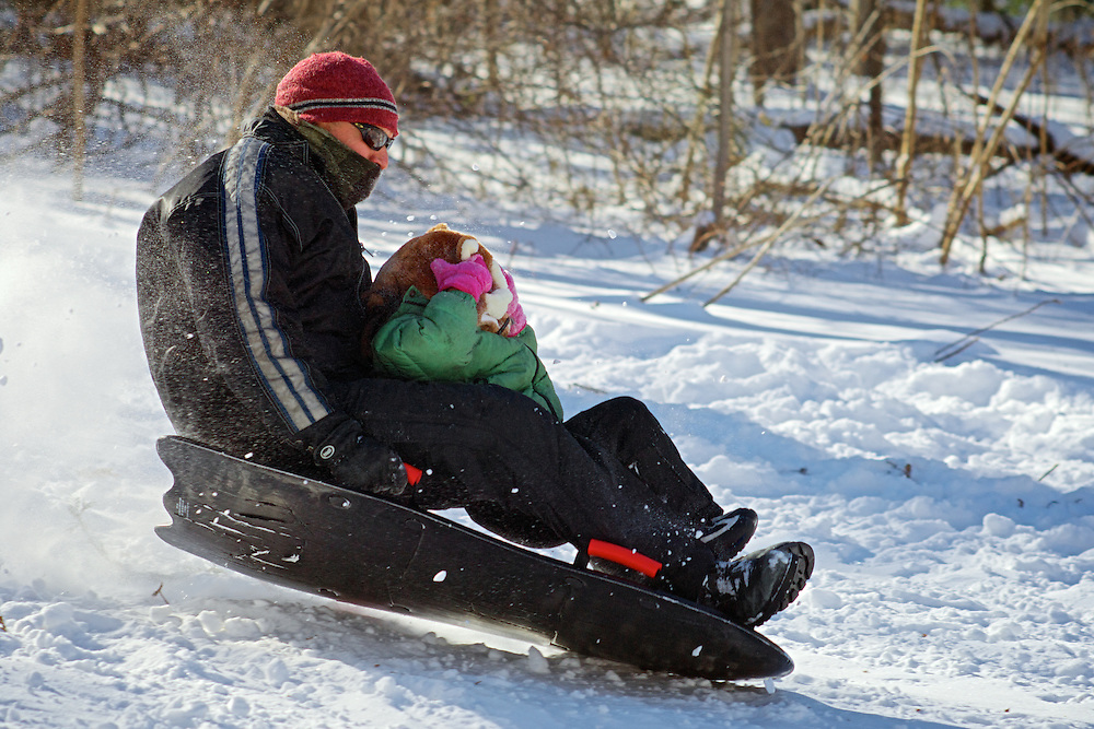 Winter scenes on the sledding hill near Thomas Mansion in Northwest Philadelphia. The day after winter storm Janus dumped more than a foot of snow in the area only a handful brought their sleds and skies to the steep hill. It is said to be one of Philadelphia's hidden treasures but for some locals a family destination for generations.