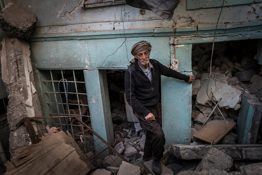 Kassim Hussein, 75, stands amongst the ruins of his home in the Old City of Mosul, which was hit by a US-led coalition airstrike during the battle to retake the city. <br />