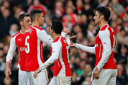 Olivier Giroud of Arsenal (R) celebrates scoring a goal to make it 1-0 - Photo mandatory by-line: Rogan Thomson/JMP - 07966 386802 - 15/02/2015 - SPORT - FOOTBALL - London, England - Emirates Stadium - Arsenal v Middlesbrough - FA Cup Fifth Round Proper.