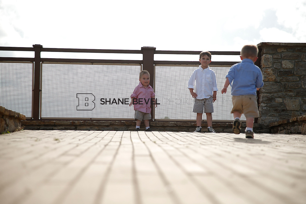 5/28/15 5:54:26 PM -- Miracle Miles and his family pose for portraits and play at the QuikTrip park for the 2015 Saint Francis Health System advertising campaign. <br /> <br /> Photo by Shane Bevel