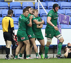 London Irish's Scott Steele celebrates scoring a try with his teammates - Photo mandatory by-line: Robbie Stephenson/JMP - Mobile: 07966 386802 - 05/04/2015 - SPORT - Rugby - Reading - Madejski Stadium - London Irish v Edinburgh Rugby - European Rugby Challenge Cup