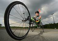 Jason Robinson, 10, was born with spina bifida and will be racing in the wheelchair race of the Boilermaker 15K Road Race for his first time. Robinson trains with his father James Robinson Wednesday evening with other runners at SUNYIT, July 3, 2013, in Marcy.
