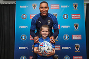 AFC Wimbledon defender Terell Thomas (6), Mascot during the EFL Sky Bet League 1 match between AFC Wimbledon and Lincoln City at the Cherry Red Records Stadium, Kingston, England on 2 November 2019.