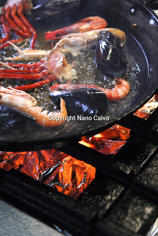 Assorted crayfish being fried for a typical spanish paella. Savina Restaurant, Ibiza, Spain