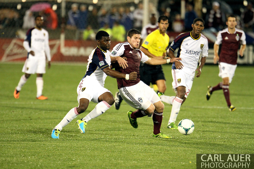 August 3rd, 2013 - Colorado Rapids midfielder Dillon Powers (8) and Real Salt Lake forward Robbie Findley (10) battle for control of the ball in the second half of action in the Major League Soccer match between Real Salt Lake and the Colorado Rapids at Dick's Sporting Goods Park in Commerce City, CO