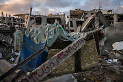 A destroyed building in Shejaiya, family write their names on rumbles once where their homes