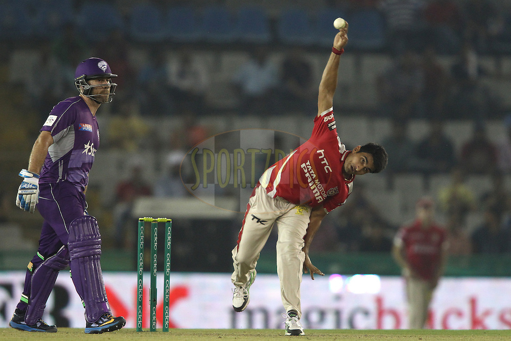 Aiden Blizzard of the Hobart Hurricanes backs up as Karanveer Singh of the Kings XI Punjab sends down a delivery during match 2 of the Oppo Champions League Twenty20 between the Kings XI Punjab and the Hobart Hurricanes held at the Punjab Cricket Association Stadium, Mohali, India on the 18th September 2014<br /> <br /> Photo by:  Shaun Roy / Sportzpics/ CLT20<br /> <br /> <br /> Image use is subject to the terms and conditions as laid out by the BCCI/ CLT20.  The terms and conditions can be downloaded here:<br /> <br /> http://sportzpics.photoshelter.com/gallery/CLT20-Image-Terms-and-Conditions-2014/G0000IfNJn535VPU/C0000QhhKadWcjYs