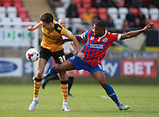Newport County player Aaron Collins and Dagenham midfielder Andre Boucaud compete for possession during the Sky Bet League 2 match between Dagenham and Redbridge and Newport County at the London Borough of Barking and Dagenham Stadium, London, England on 19 September 2015. Photo by Bennett Dean.